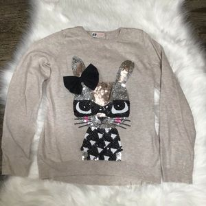 H and m tan color sweater with sequined rabbit.